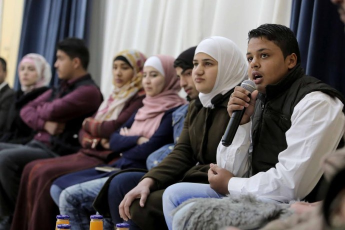 Youth participants engage in discussion during USAID's Non-Formal Education Program launch event in Ma'an, Jordan. / Mohammad Maghayda for USAID