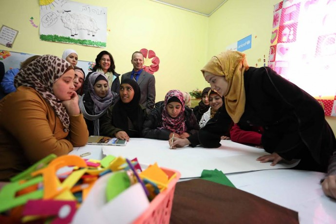 Deputy Assistant Administrator Mona Yacoubian watches as youth in Ma'an, Jordan engage in activities during USAID's Non-Formal Education Program launch event. / Mohammad Maghayda for USAID