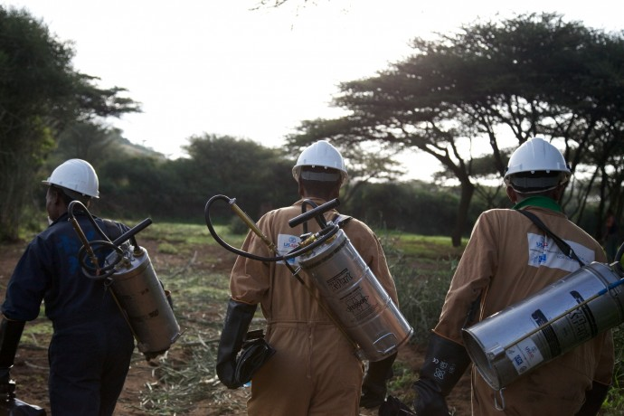 A malaria control team heads out to a rural village in Kenya to provide indoor residual spray services. / Brant Stewart, RTI/Courtesy of PMI