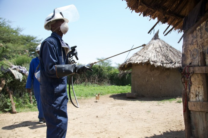 A member of a local malaria control team in Ethiopia gets ready to apply indoor residual spray. Brant Stewart, RTI/Courtesy of PMI