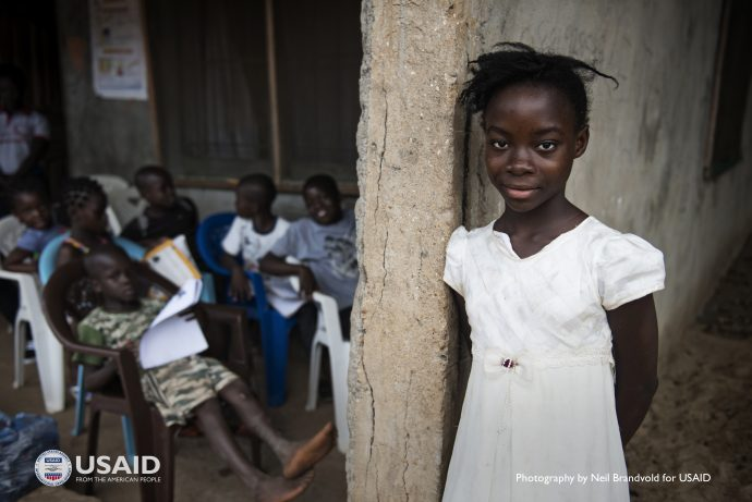Victoria Cole, 12, hasn't let the Ebola crisis interrupt her education. Here she participates in in an outdoor classroom while schools in Liberia were closed during the height of the Ebola epidemic / Neil Brandvold for USAID