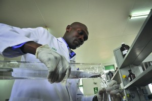 An analyst at the National Quality Control Laboratory in Kenya conducts a test on a pharmaceutical sample. / Tobin Jones, Chemonics