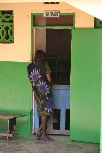 Chantal, an HIV-positive woman, waits for her monthly supply of antiretroviral medication at the Hôpital Immaculée Conception in Haiti. / Jean Jacques Augustin, SCMS