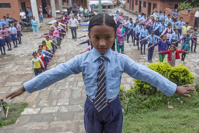 Children attend a morning assembly at a temporary learning center in Nepal / Kashish Das Shrestha for USAID/Nepal