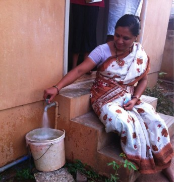 Each year, a household in India loses an estimated seven days waiting for intermittent water. NextDrop seeks to reduce consumers' coping costs in developing countries. / NextDrop