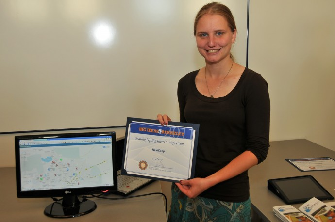 Emily Kumpel, representing the NextDrop team, accepts an award in 2011 to scale up the team's pilot study in Hubli-Dharwad. / Big Ideas Contest