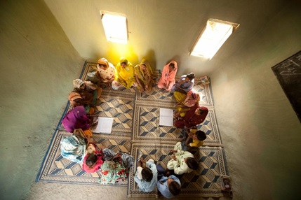 Girls sit in a circle in a classroom in Pakistan. / Save the Children