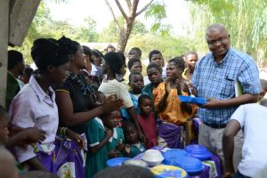 Emmanuel Ngulube visits programs in the field. /USAID