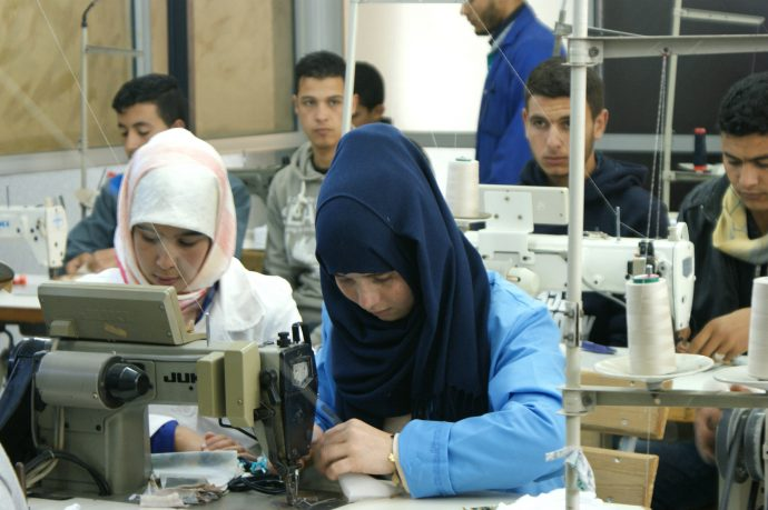 Nova Moda 2, a clothing factory where many graduates from USAID-supported vocational training centers like the Chifae Association become interns or employees. /USAID