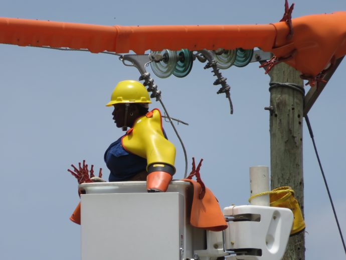 A live line crew member at work for Kenya Power and Lighting Co. /Ellen Dragotto, USAID