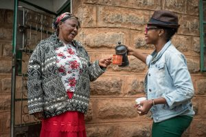 Vava Angwenyi of Vava Coffee shares coffee with a coffee farmer and supplier in Kenya. Vava's social enterprise is being supported by USAID's Partnering to Accelerate Entrepreneurship Initiative through partner Intellecap. /Vava Coffee