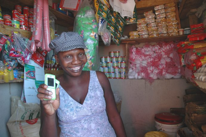 After the 2010 earthquake in Haiti, merchants such as Belleus Pierre, 31, used T-Cash to sell basic food staples to families benefiting from the USAID-funded food assistance program implemented by Mercy Corps. Her participation in the program meant she had a steady flow of customers to her store, providing her own family with much needed income. /Lisa Hoashi, Mercy Corps