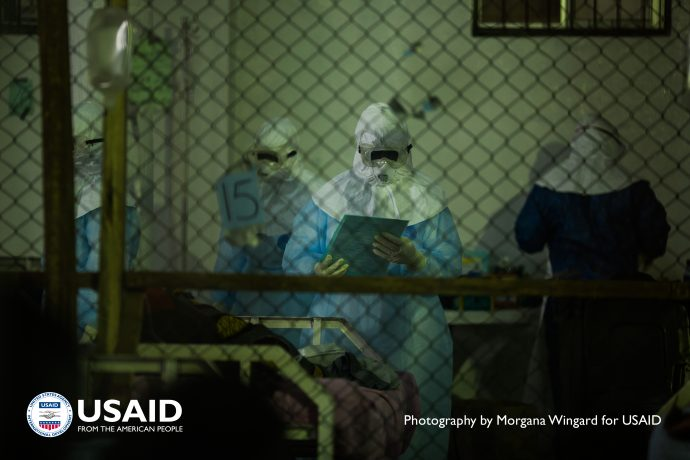 A health care worker checks on patients admitted to the Ebola Treatment Unit in the Island Clinic, Monrovia, Liberia, Sept. 22, 2014. /Morgana Wingard