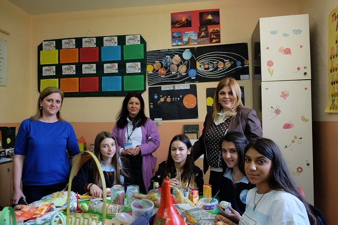 "Ethnic Albanian and Macedonian students, teachers and school principal take a break during a joint art project in preparation for the Easter holiday in the primary school ""Naum Ohridski"" in Skopje, Macedonia. Credit: Kristen Byrne, USAID"