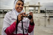 Nusrat Bibi, an acid burn survivor, takes photographs during a field trip for a photography workshop. / Diego Sanchez, USAID