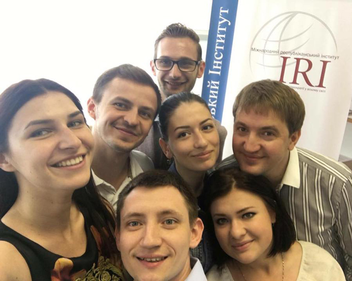 Expert trainers, including Taras Sluchyk, gather with participants of IRI's USAID-supported Youth Political Leadership Academy in Dnipro, Ukraine, following a training. / IRI