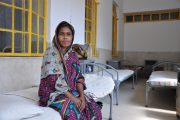 Sukuri waits for fistula surgery at Kumundi Hopital in March, 2014. Locked in a cycle of her husband leaving her to remarry and then returning to her, she hopes for the repair of her fistula and a united family. / Amy Fowler, USAID
