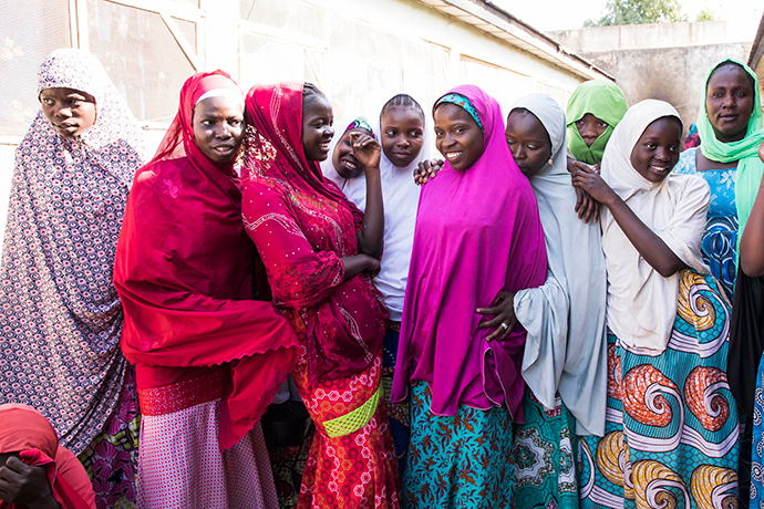 Aisha Mohammed (third from left), age 17, and her friends take a break after classes at a USAID-funded non-formal learning center in the capital of Borno State, in Nigeria. Erick Gibson/Creative Associates International for USAID