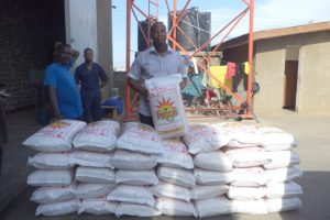 Founder of Food for All Africa, Chef Elijah donates bags of recovered rice to beneficiaries.