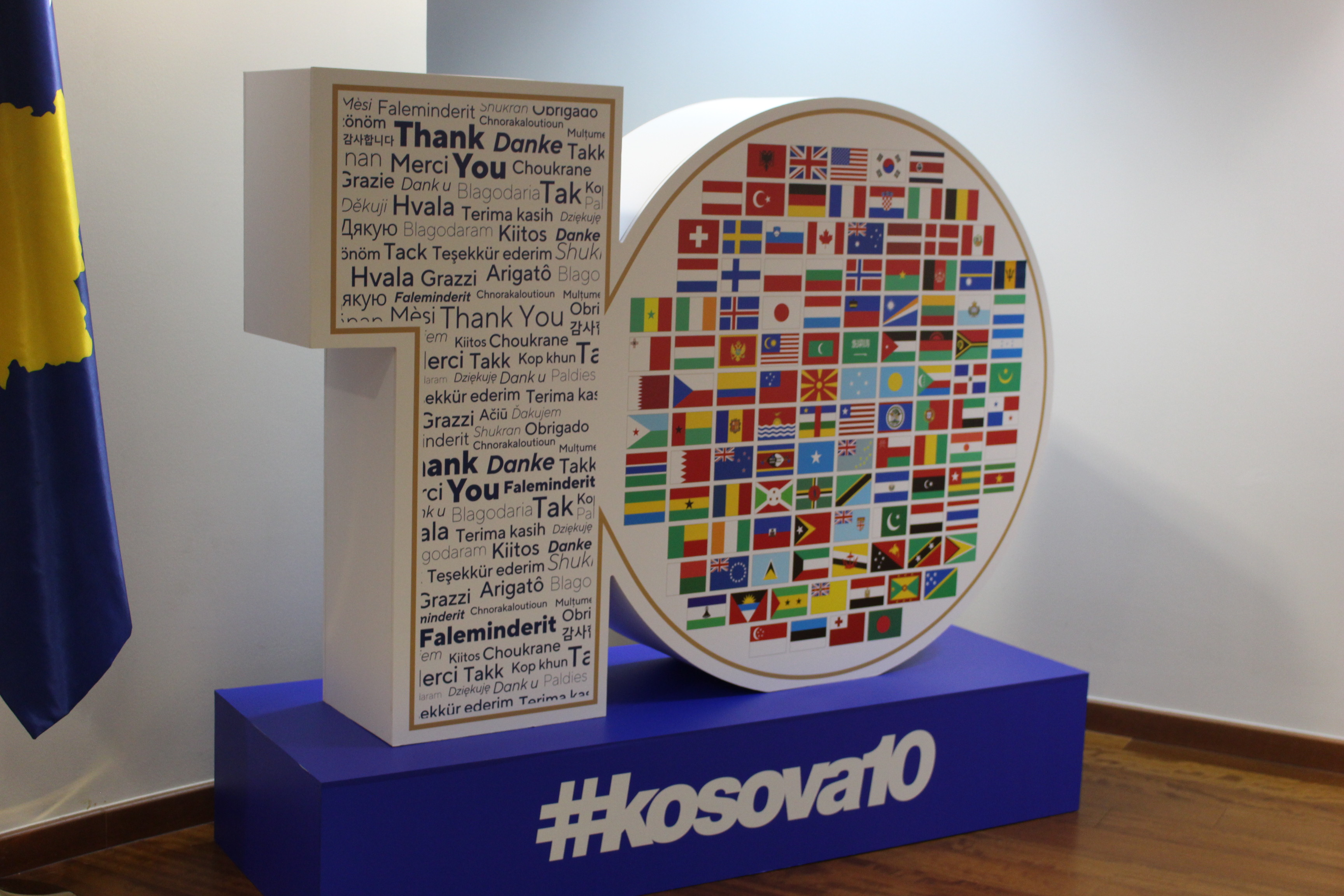A graphic display commemorating USAID's 10 years in Kosovo, with a hashtag #kosovo10 printed on the base.
