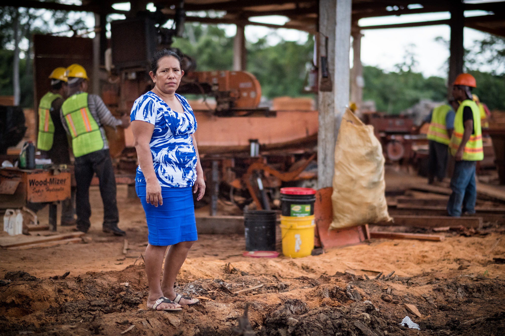 A woman stands outside a workshop